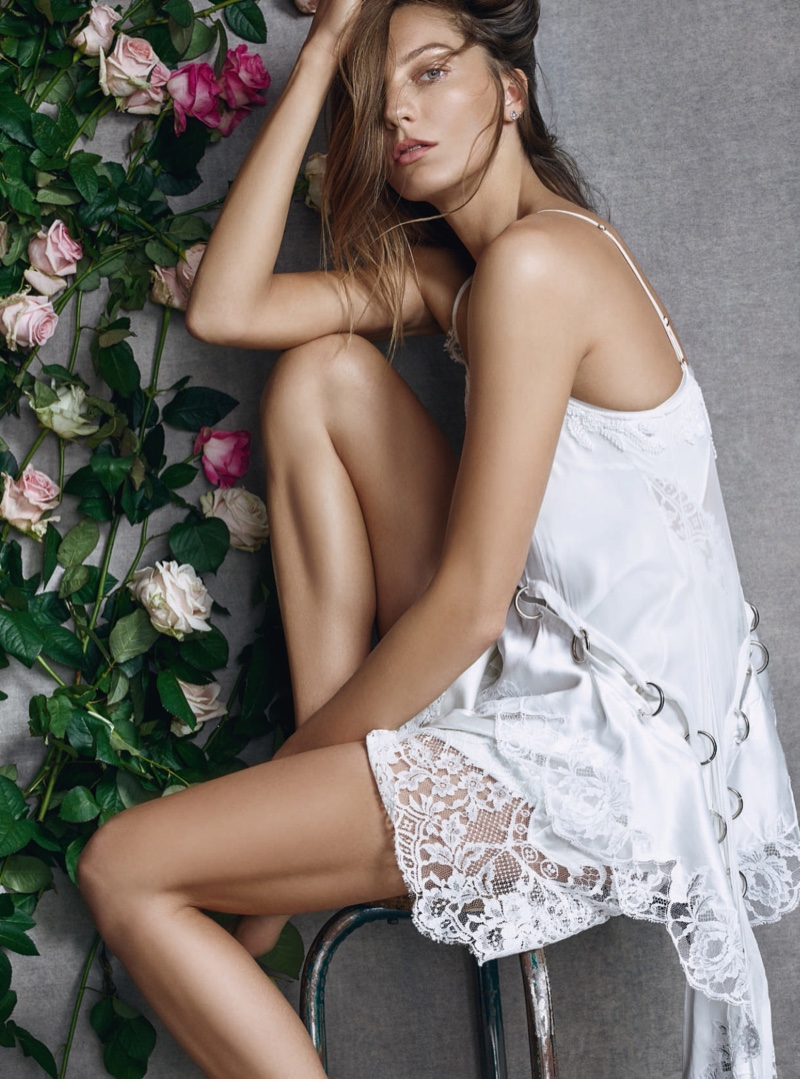 The model wears a slip dress with lace