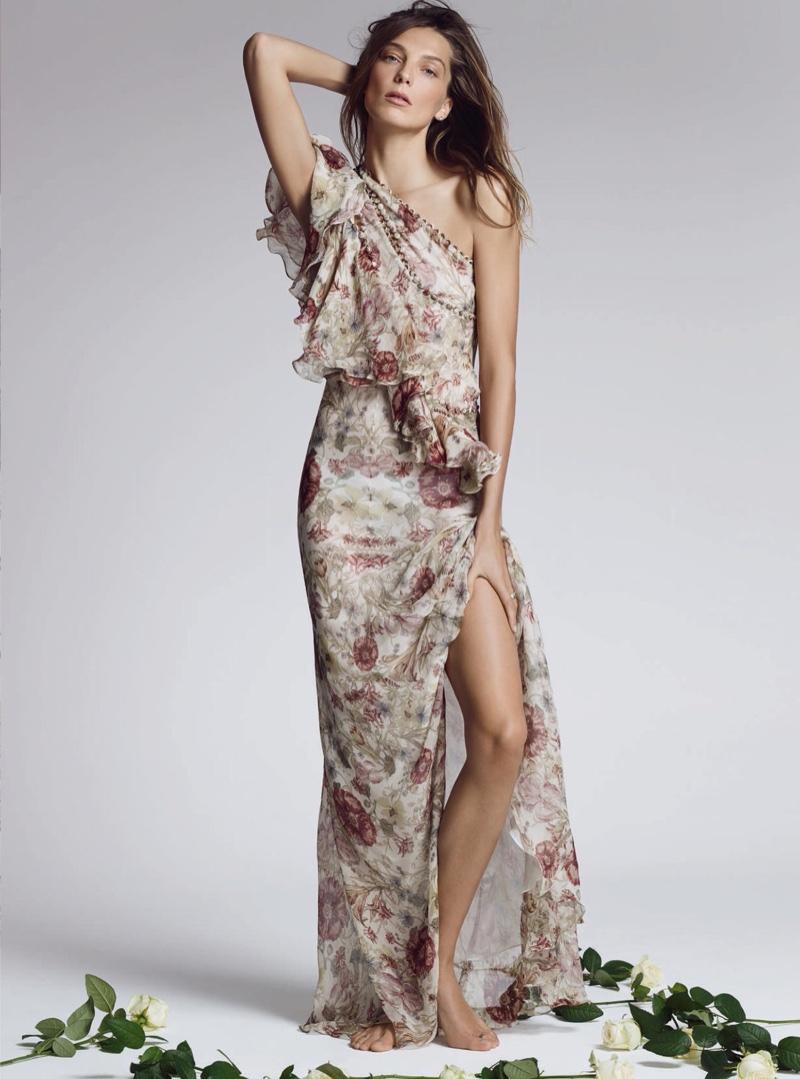 Hitting the studio, Daria models a floral print dress with ruffles