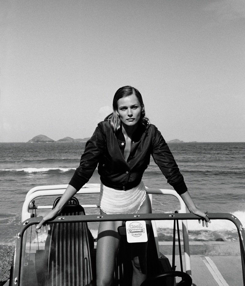 Photographed in black and white, Edita wears Chanel jacket with She Made Me swimsuit