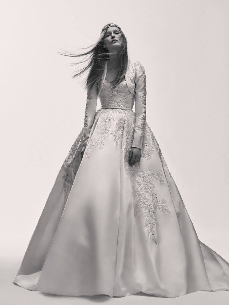 A model wears an empire waist wedding dress from Elie Saab's spring 2017 bridal collection