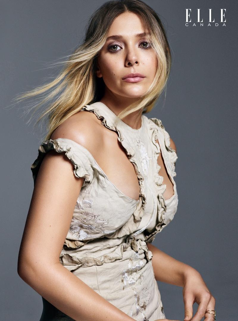 Posing in an Alexander McQueen dress with cutout detail, Elizabeth Olsen stars in ELLE Canada