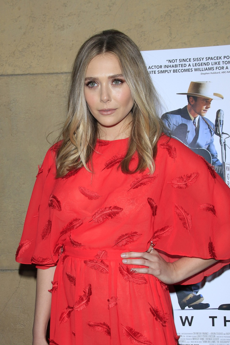 MARCH 2016: Elizabeth Olsen attends the Los Angeles premiere of I Saw the Light wearing a red Emilio Pucci dress. Photo: Joe Seer / Shutterstock.com