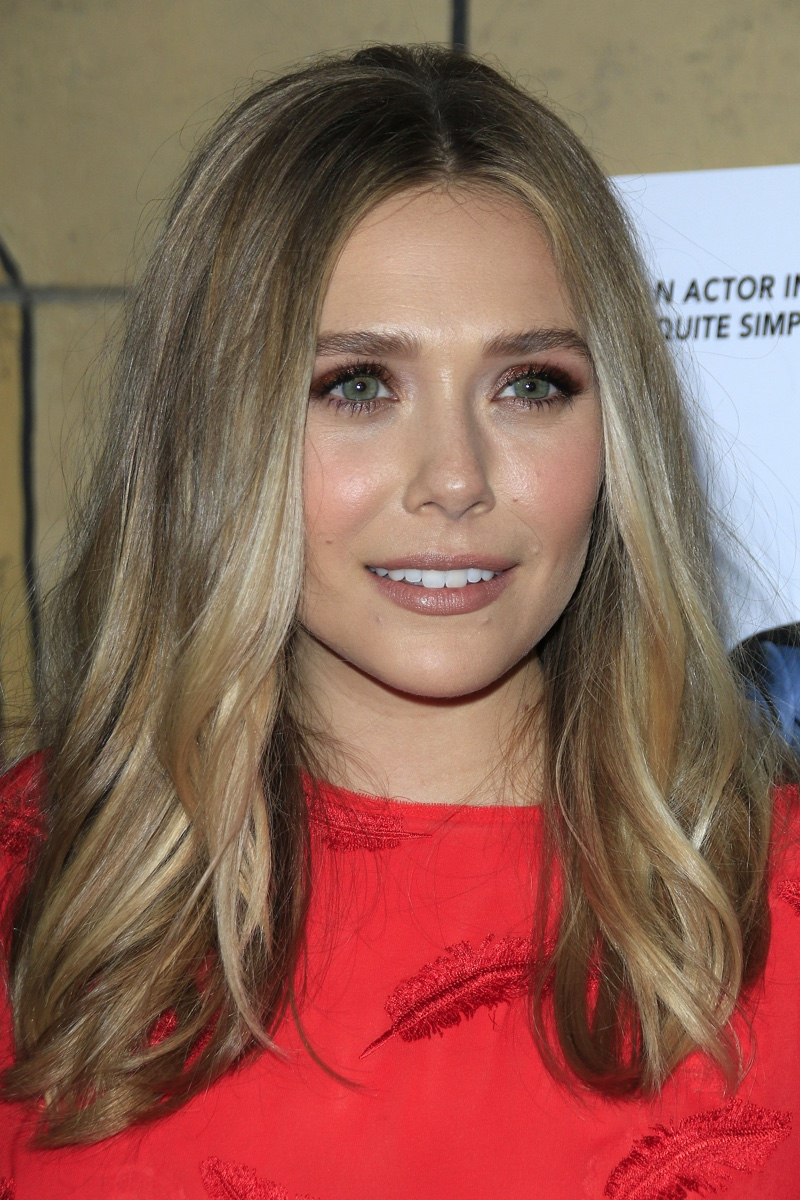 MARCH 2016: Elizabeth Olsen attends the Los Angeles premiere of I Saw the Light wearing a wavy hairstyle at medium-length. Photo: Joe Seer / Shutterstock.com