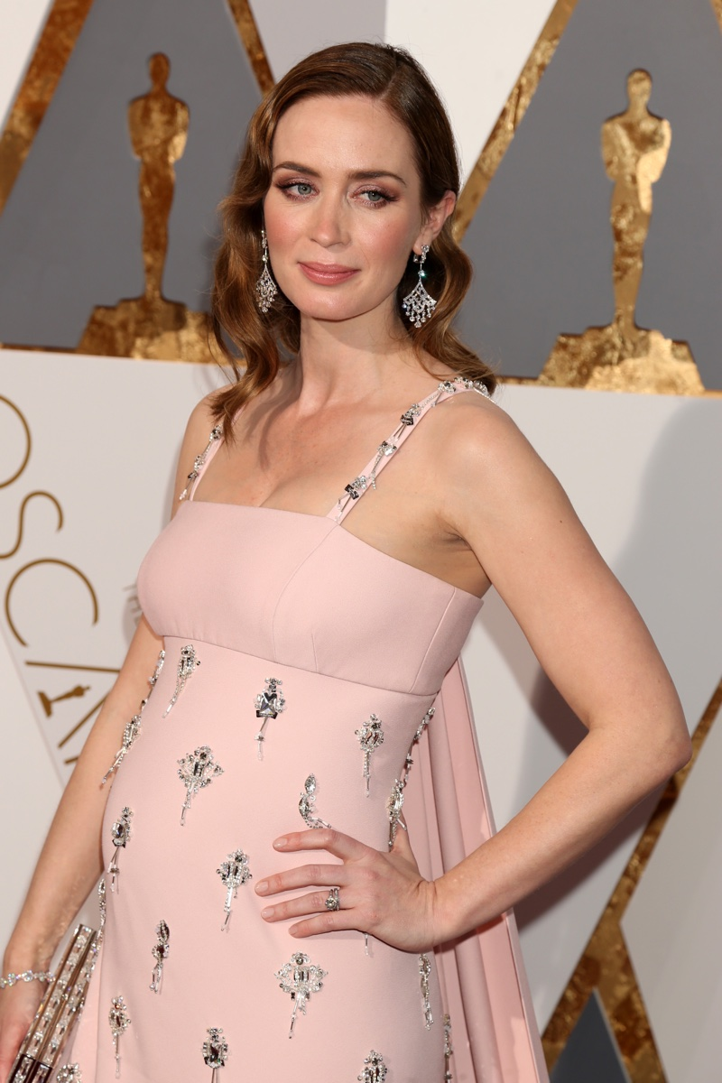 FEBRUARY 2016: A pregnant Emily Blunt attends the 2016 Oscars wearing a pink Prada dress with crystals: Photo: Helga Esteb / Shutterstock.com