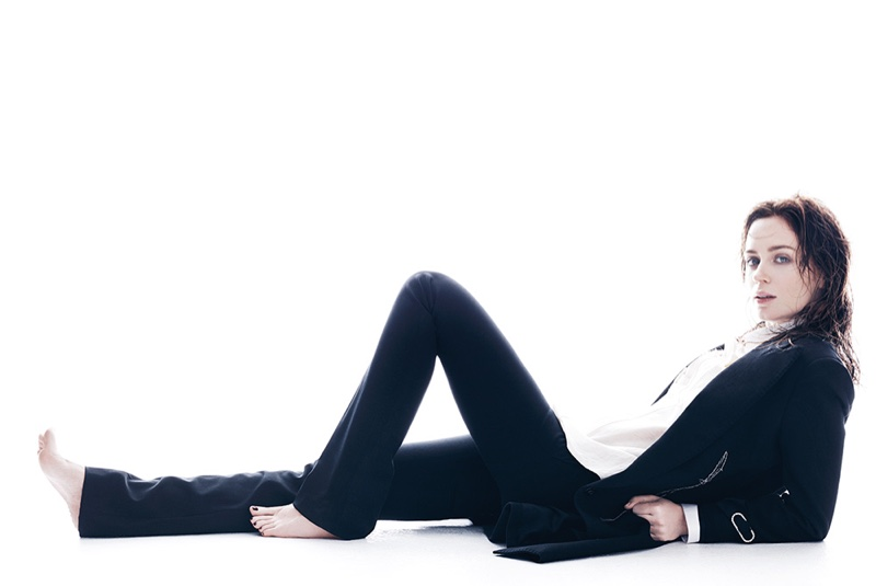 Posing on the ground, Emily Blunt suits up in a Lanvin coat and shirt with Bally pants