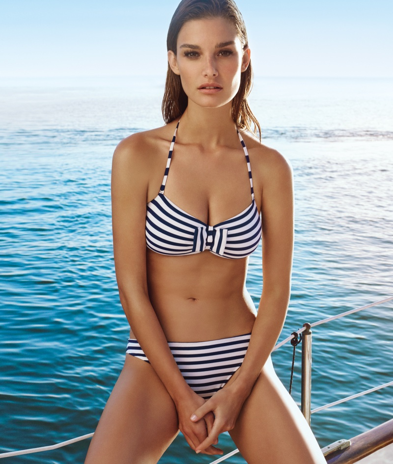 Ophelie poses at sea in a striped bikini look from Etam's spring 2016 collection