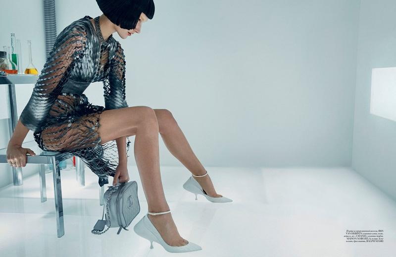 Josephine flaunts some leg in an Iris van Herpen silver dress with a Chanel handbag and Maison Margiela heels