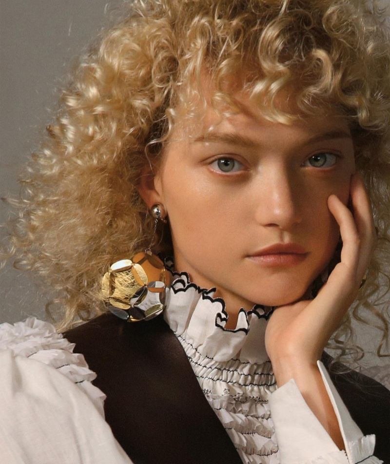 Gemma Ward models blonde curls in the fashion editorial