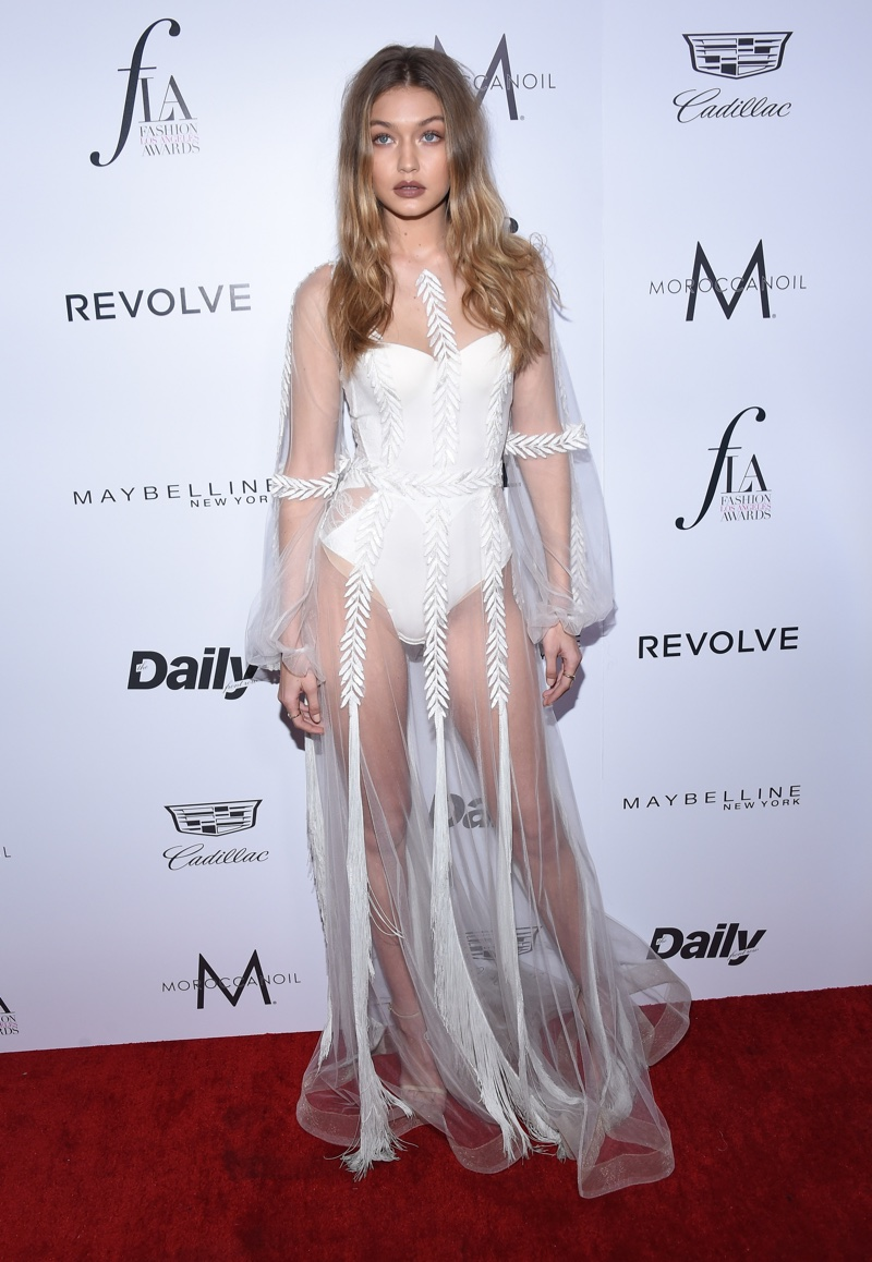 MARCH 2016: Gigi Hadid attends the 2016 Daily Front Row Los Angeles Awards wearing a sheer Yanina Couture gown. Photo: DFree / Shutterstock.com