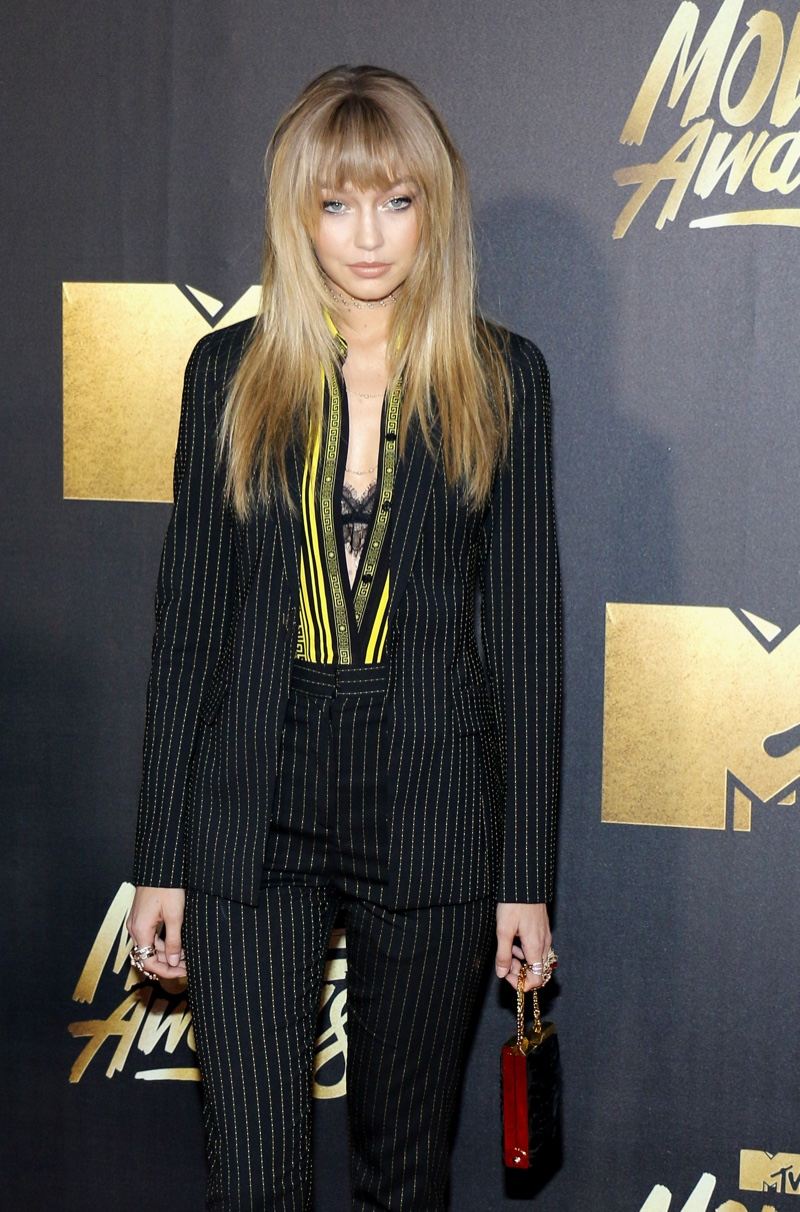 APRIL 2016: Gigi Hadid attends the 2016 MTV Movie Awards wearing a Versace pantsuit