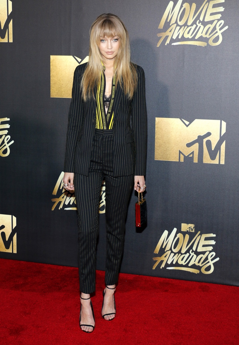 Gigi Hadid hit the red carpet in a Versace top and striped pantsuit. Photo: Tinseltown / Shutterstock.com
