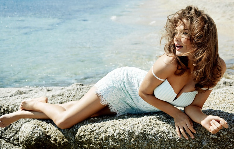 Serve pure bombshell in a Guess little white dress adorned with lace