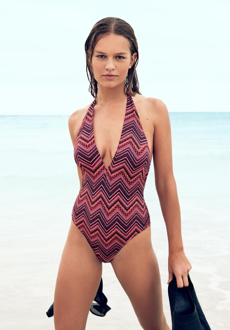 Wearing a one-piece swimsuit, Andreea Diaconu stars in H&M's summer 2016 campaign