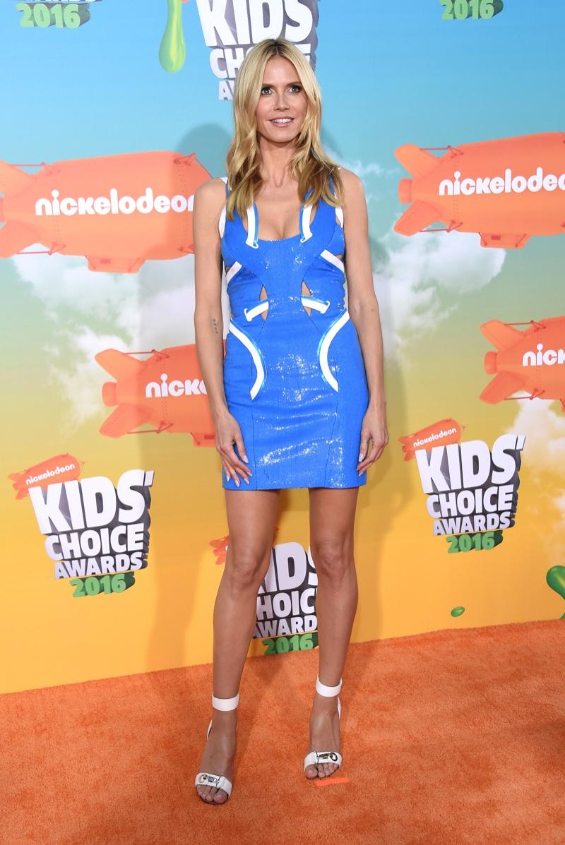 MARCH 2016: Heidi Klum attends the 2016 Kids' Choice Awards wearing a blue Versace mini dress with cutouts. Photo: DFree / Shutterstock.com