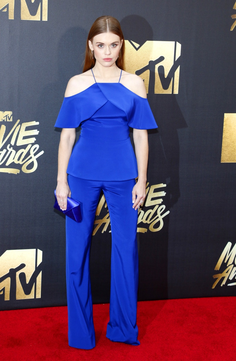 Teen Wolf star Holland Roden walked the red carpet in a blue Christian Siriano top and pants. Photo: Tinseltown / Shutterstock.com