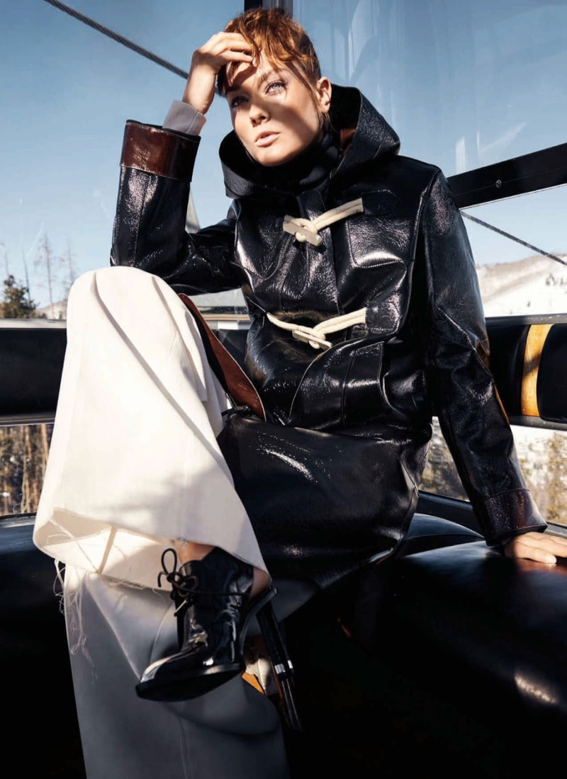 The model hits the slope in high fashion ski style