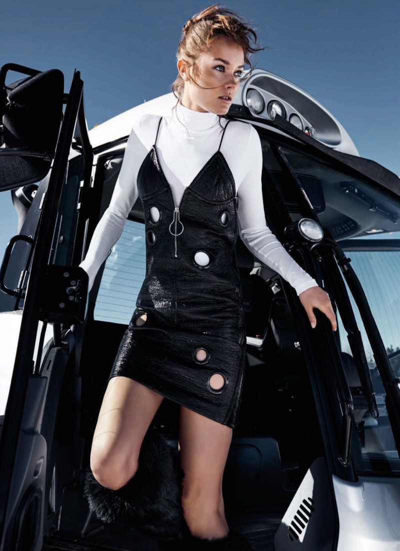 Posing in black and white, Jac models a black Bally dress with grommets and long-sleeve Falke top