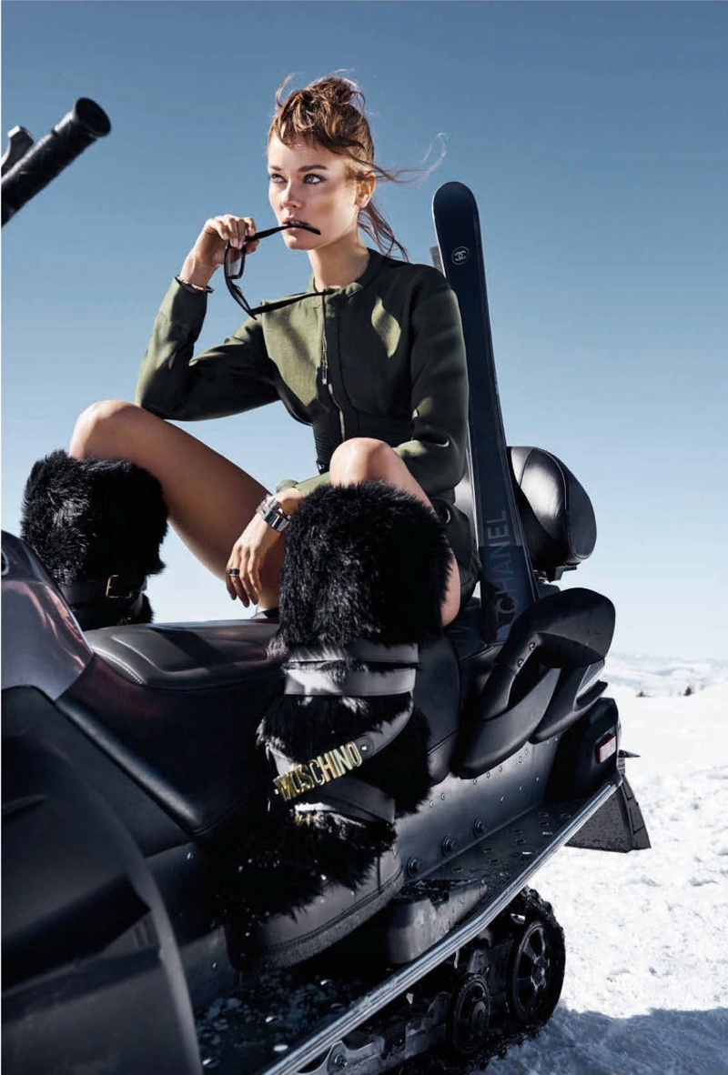 Looking ready to take on the slopes, the model wears Versace top and shorts with Moschino boots