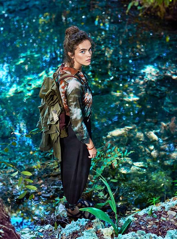 Captured outdoors, Jena Goldsack wears Valentino jacket with camouflage looking print