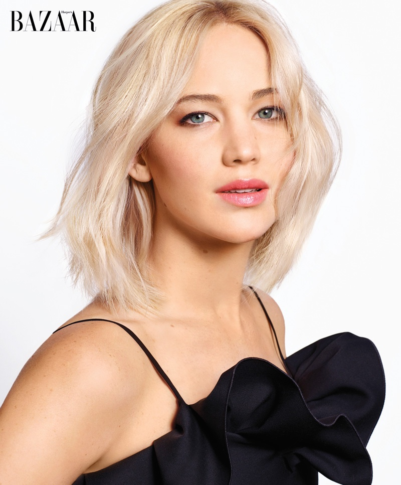 Jennifer Lawrence poses in a black Dior Haute Couture dress with ruffle embellishment