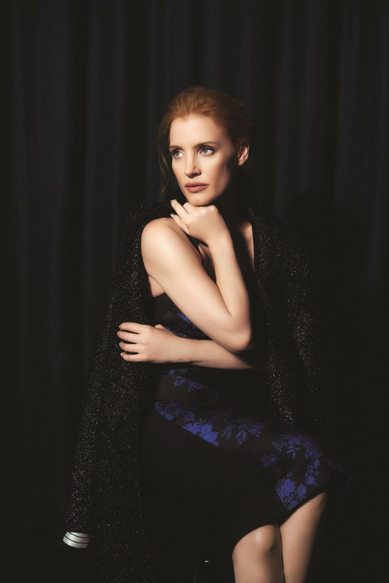 Jessica Chastain wears a Monse twill coat with Stella McCartney black floral dress