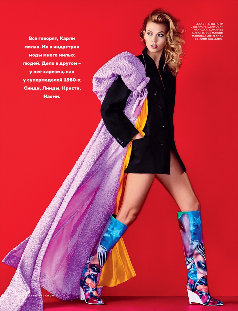 Karlie Kloss shows some leg in a jacket and multi-colored boots from Maison Margiela Artisanal