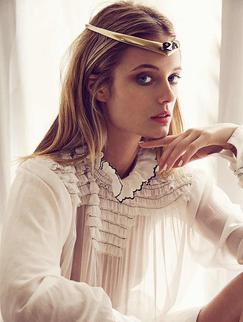 The model wears sheer Louis Vuitton top with headpiece