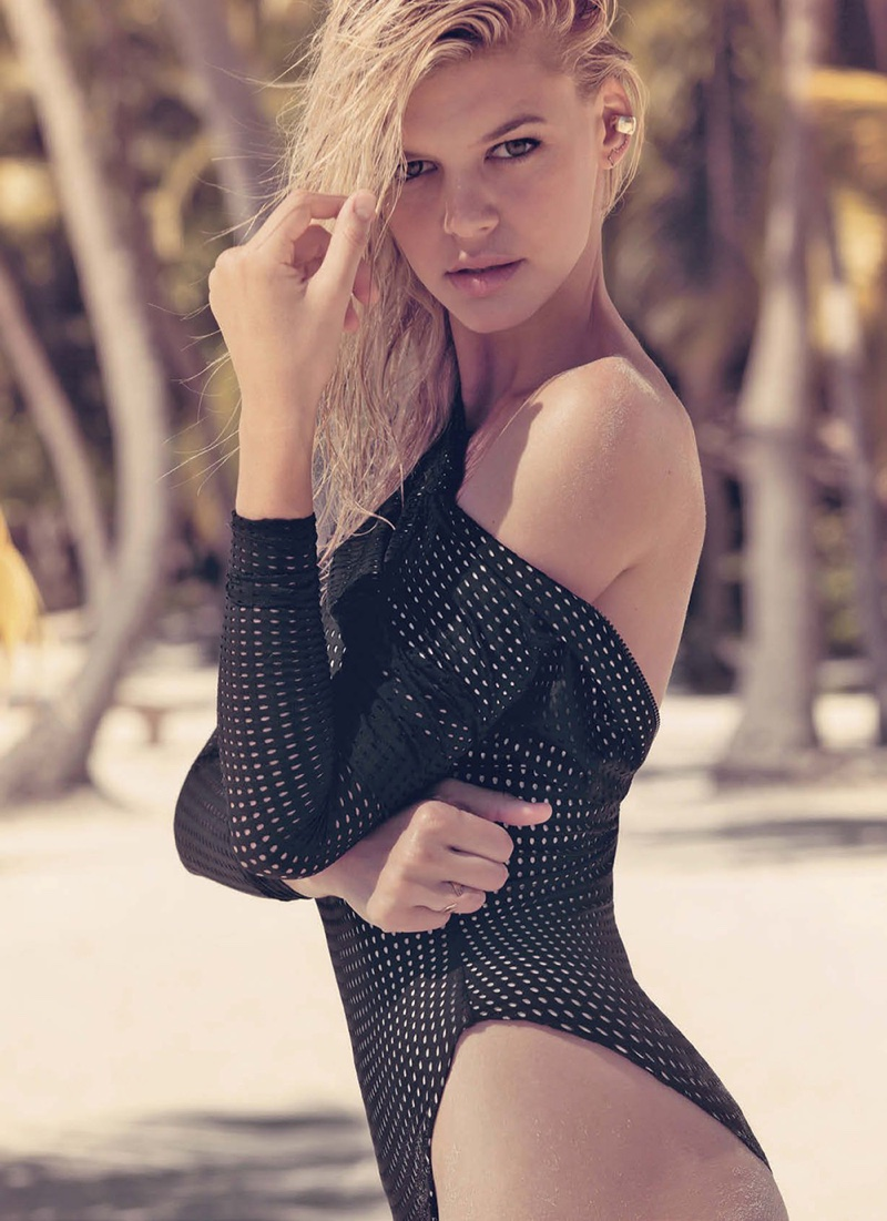 The blonde model flaunts her curves in an Acacia one-piece swimsuit
