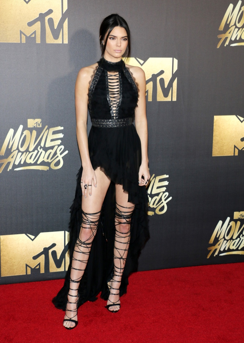 Kendall Jenner walked the red carpet in a black Kristian Aadnevik dress with a high-low hemline and DSquared2 gladiator heels. Photo: Tinseltown / Shutterstock.com