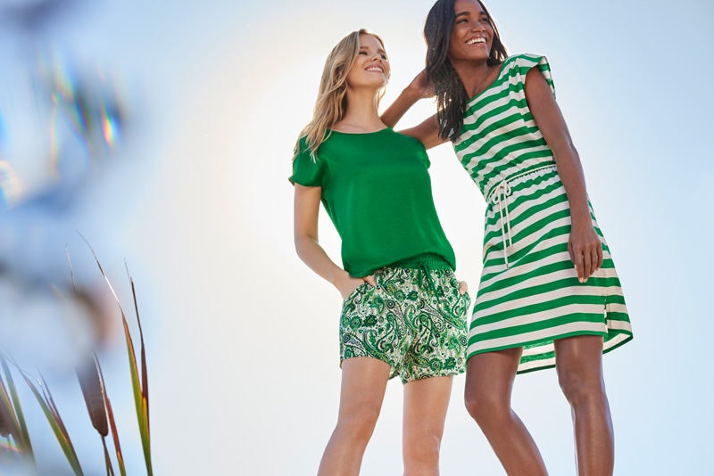 Looking good in green, Marloes wears a green top and printed shorts while Arlenis models a striped sleeveless dress