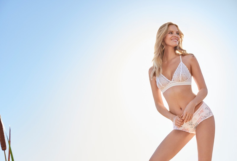 Photographed outdoors, Marloes poses in a white bra and briefs set from Lindex's summer 2016 collection