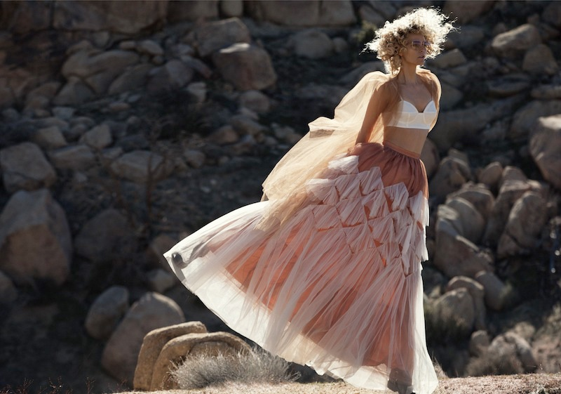 Sarah Deanna models a white bra top and tulle skirt from Dries Van Noten