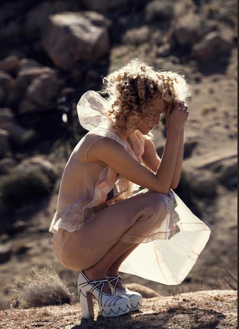 Sarah Deanna poses in a sheer dress from Miu Miu