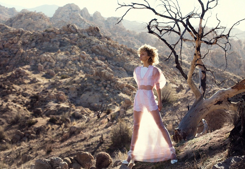 Sarah poses in the California desert wearing a sheer Dior dress over white lingerie top and shorts