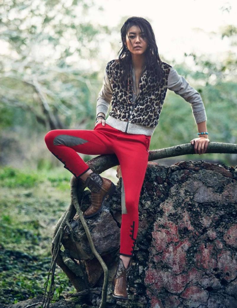 Posing outdoors, Liu Wen wears Bottega Veneta sweater with leopard print and red trousers