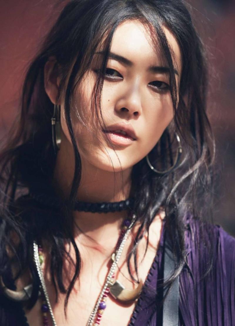 Getting her closeup, Liu Wen wears her hair in tousled waves with shimmering eyeshadow
