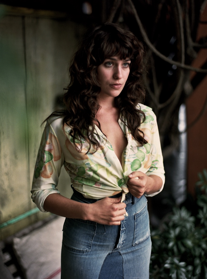 Lola Kirke poses in high-waisted denim skirt and blouse