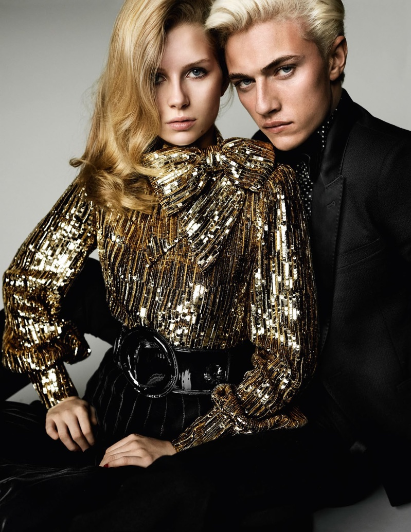 The pair glitter with Lottie modeling a sequin blouse, and Lucky wearing a tailored jacket from Saint Laurent