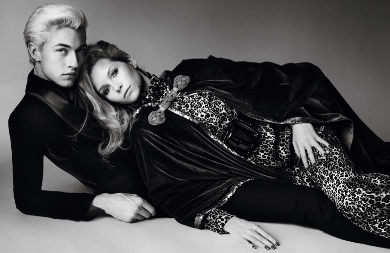 Lucky Blue Smith and Lottie Moss lounge in this black and white photograph