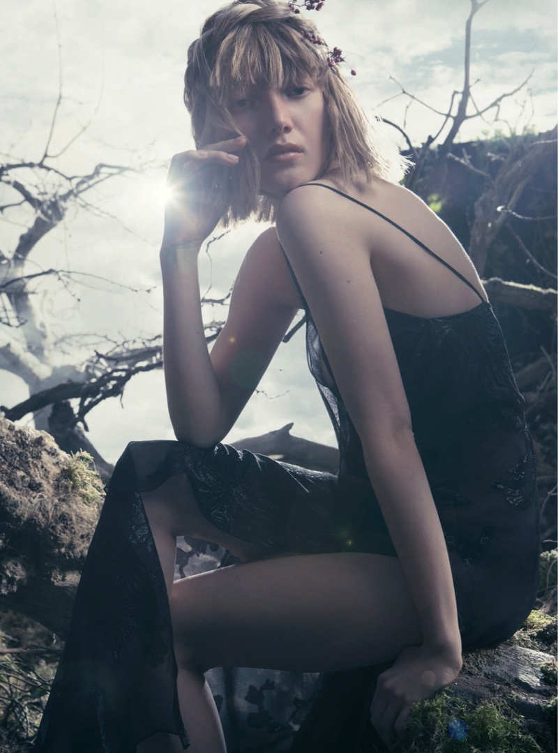 The model wears dreamy dresses in the fashion editorial