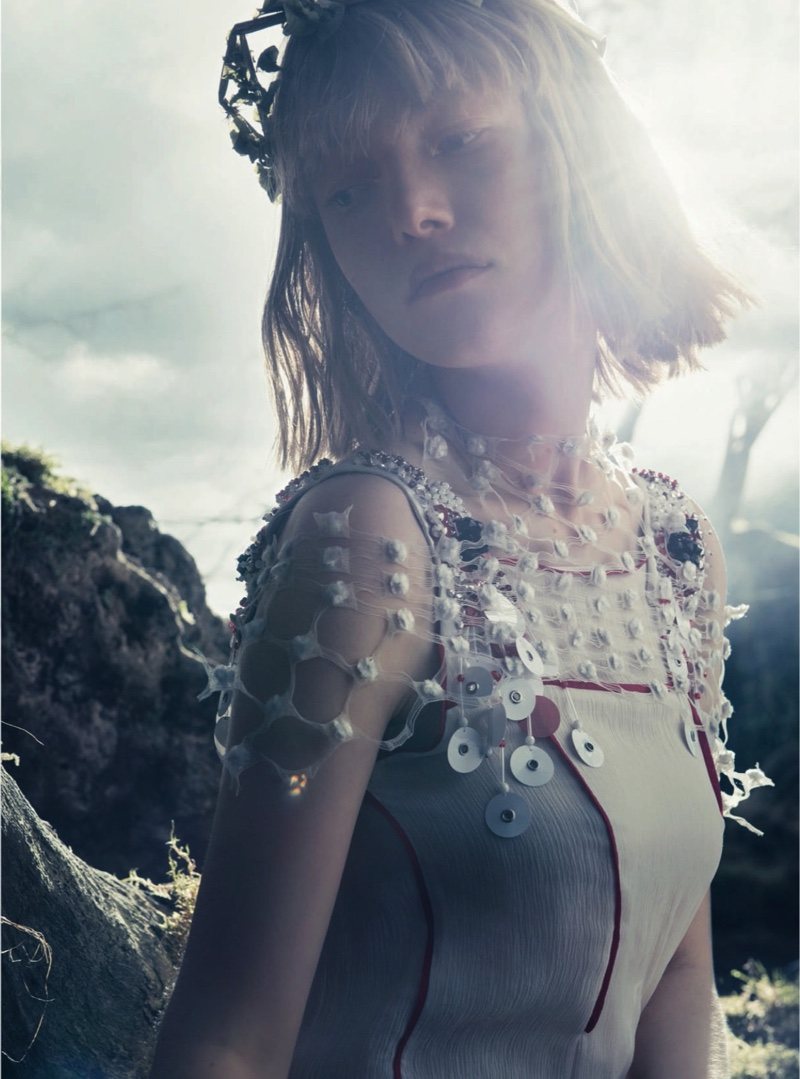 The model looks ethereal in a Prada cover-up and top