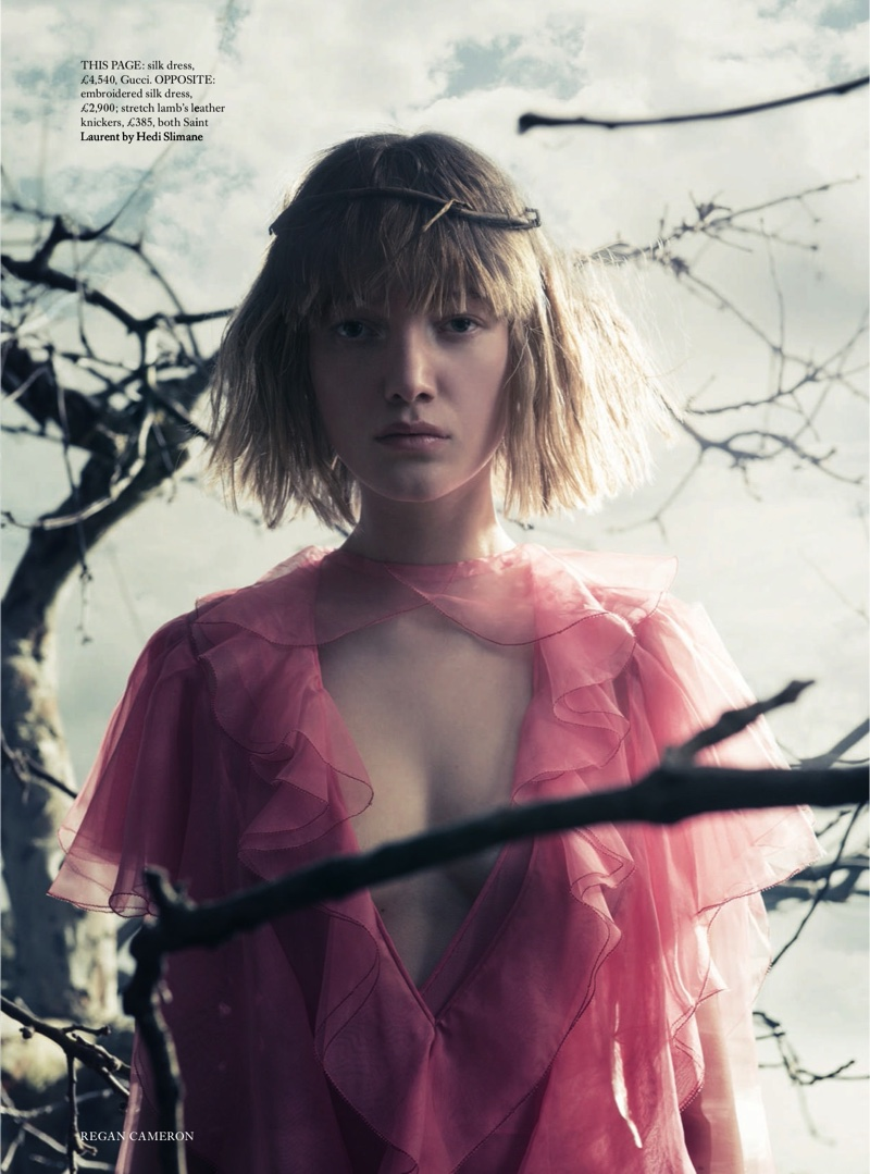 Looking pretty in pink, Lou Schoof wears a pink Gucci silk dress with ruffles