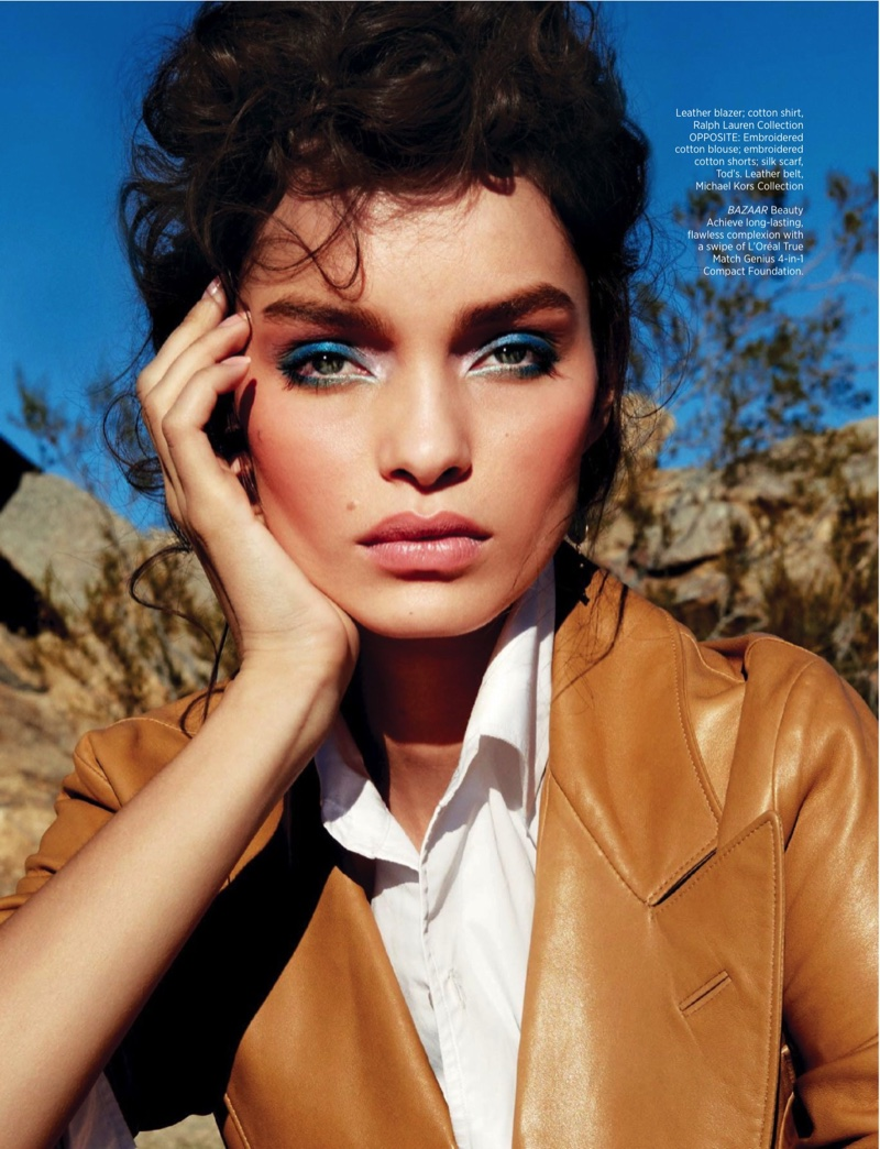 Luma Grothe enchants with shimmering blue eyeshadow while wearing a Ralph Lauren Collection leather blazer