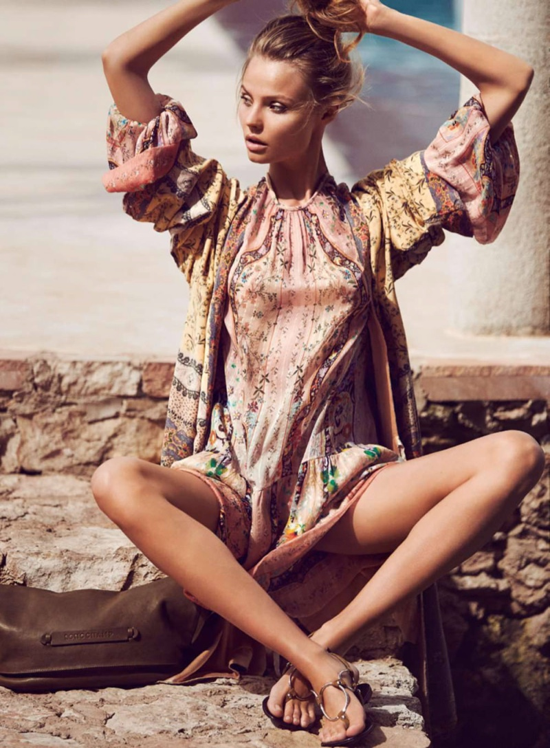Magdalena wears an Etro top and dress made of silk with flat sandals