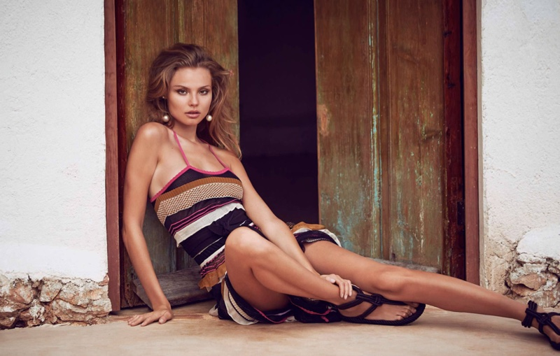Magdalena Frackowiak brings the heat in a striped maxi dress from Salvatore Ferragamo