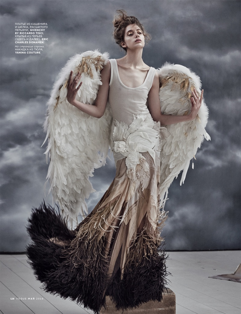 Model wears Givenchy by Riccardo Tisci skirt with gilded wings