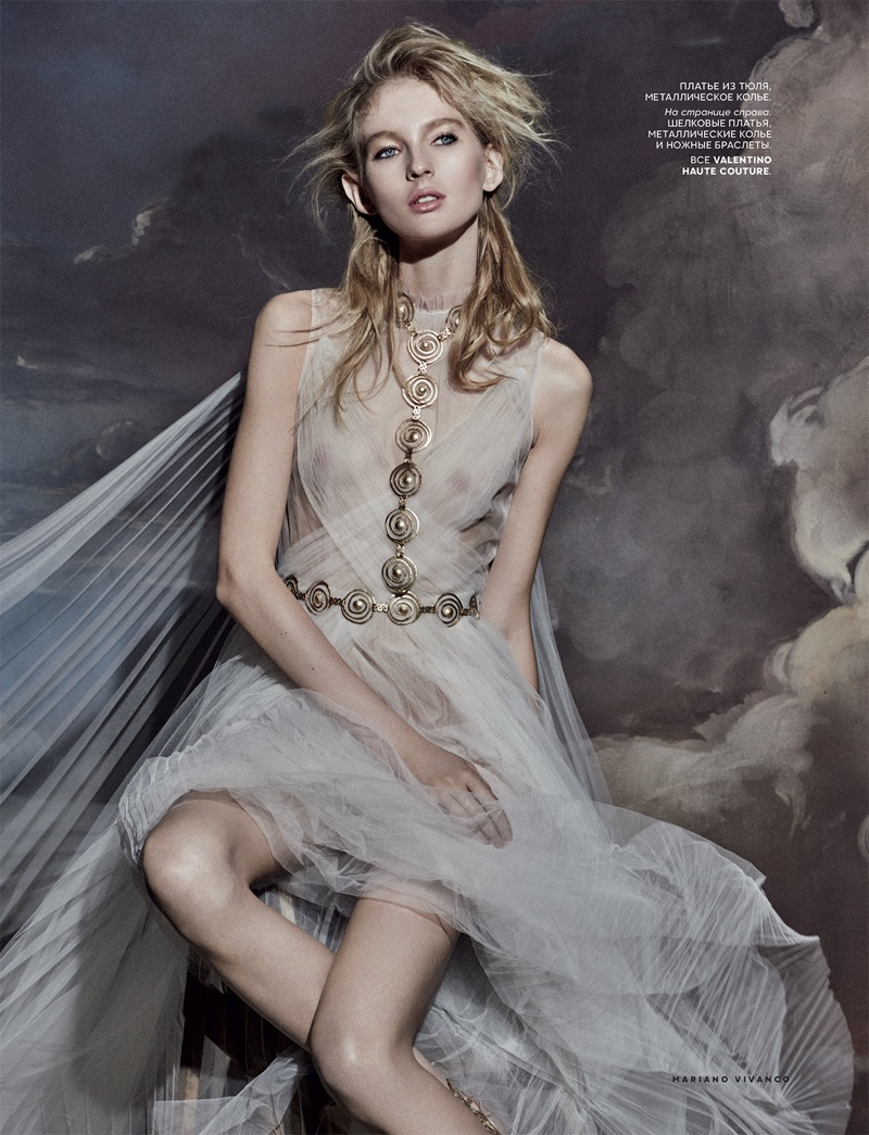 Model poses in body jewelry and sheer dress from Valentino Haute Couture