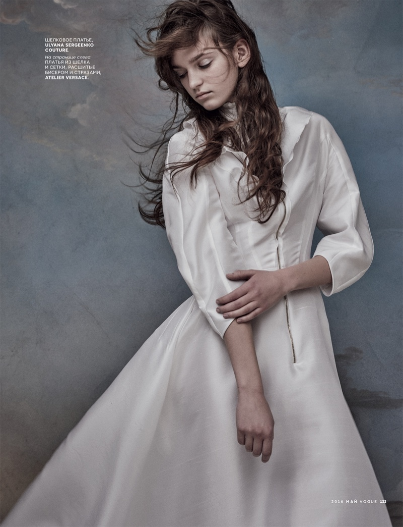 Model wears 3/4 sleeve dress by Ulyana Sergeenko Couture