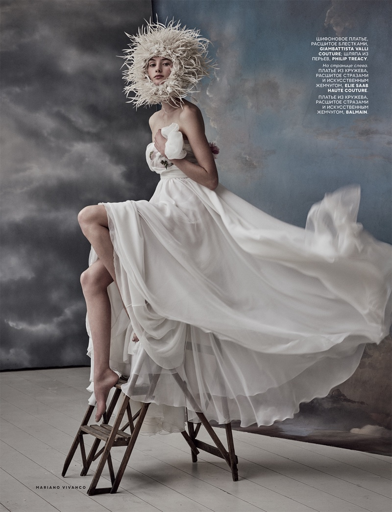 Looking ethereal, model wears Philip Treacy headpiece with white Giambattista Valli gown