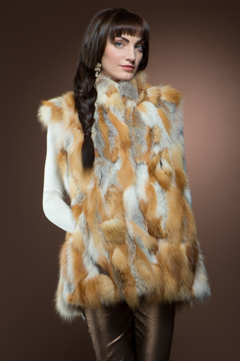 Mary McFadden Red Patchwork Fox Fur Vest $1,395 - Take on a retro look with this red fox fur vest. Sport with some skinny jeans for a cool girl look.